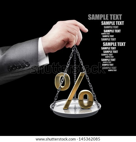 businessman hand holding Scale with procent symbols isolated on black background  - stock photo