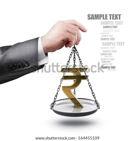 businessman hand holding Scale with symbols of currencies rupee  isolated on white background High resolution - stock photo