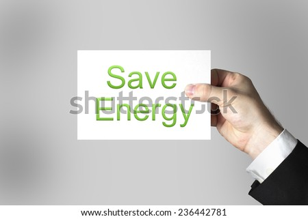 businessman hand holding small sign save energy - stock photo