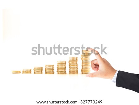 Businessman hand holding stacks of coins on white background. Growth, Investment, Start, Beginning, Again, ROI, LIT, Assurance, Insurance, Agent, Trust, Growth, Together, Confidence concept.