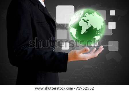 businessman hand holding the world and buttons - stock photo
