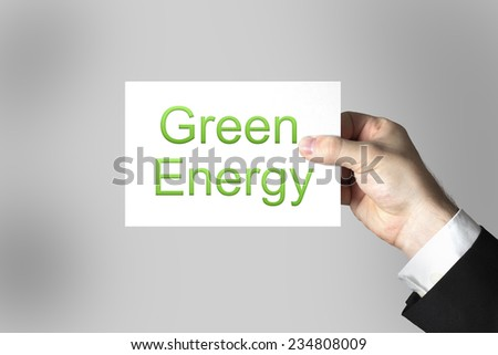 businessman hand holding white card green energy - stock photo
