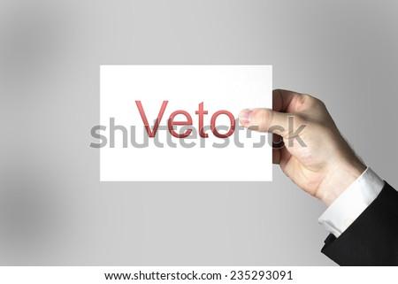 businessman hand holding white sign veto  - stock photo