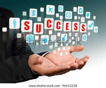 Businessman hand holding with red success alphabet streaming images - stock photo