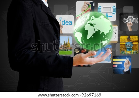 businessman hand holding world with image business collection - stock photo
