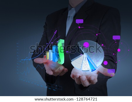 businessman hand holds graph bar and pie growth as concept - stock photo