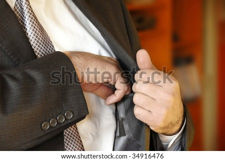 Businessman hand  in inner jacket pocket