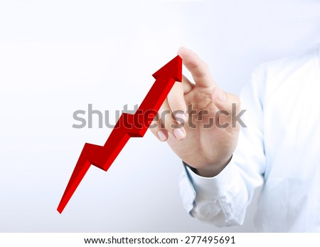 Businessman hand is pointing the Growth graph on the transparent virtual screen.