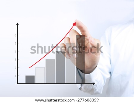 Businessman hand is pointing the growth graph on the transparent virtual screen. - stock photo