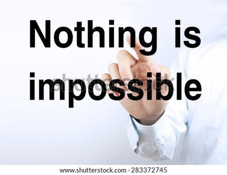 Businessman hand is pressing the concept text of Nothing is impossible. - stock photo