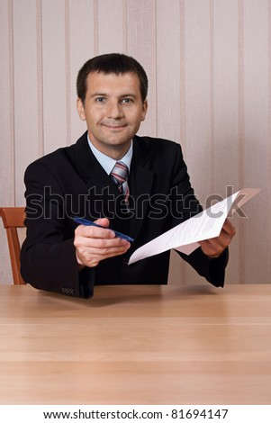 Businessman hand over a pen and a contract for signing