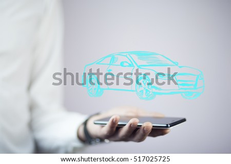 businessman hand phone with car
