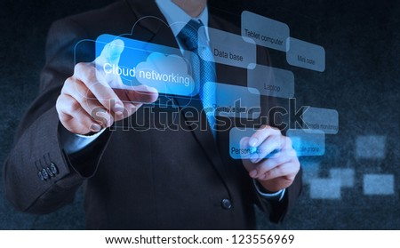Businessman hand pointing on a Cloud Computing diagram on the new computer interface - stock photo