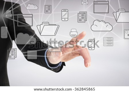 Businessman hand pointing something against grey background