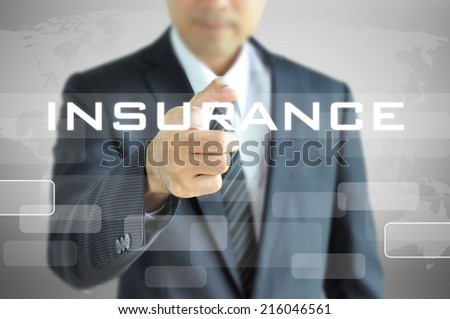 Businessman hand pointing to INSURANCE word on virtual screen - stock photo