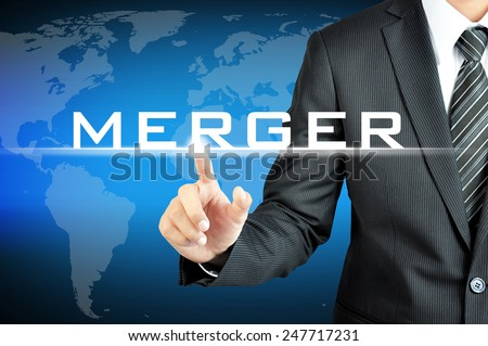 Businessman hand pointing to MERGER sign on virtual screen - stock photo