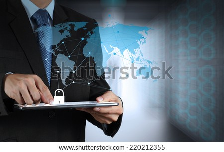 businessman hand pointing to padlock on touch screen computer as Internet security online business concept  - stock photo