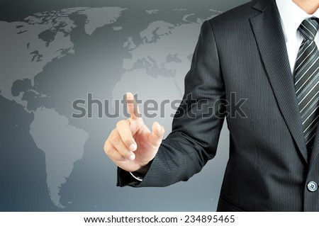 Businessman hand pointing with world map background  - can put your texts or pictures at the finger - stock photo