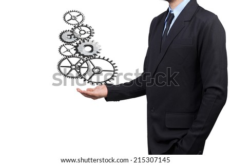 businessman hand presenting show metal gear to success as concept isolated on white background with clipping path - stock photo