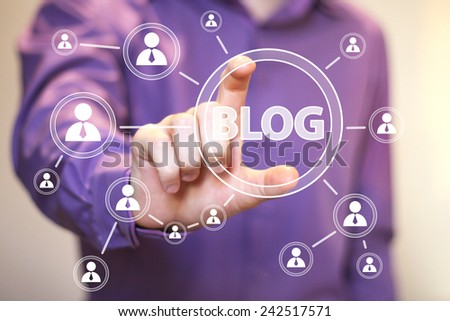 Businessman hand press web blog button - stock photo