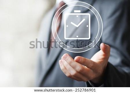 Businessman hand press web clock time button icon - stock photo