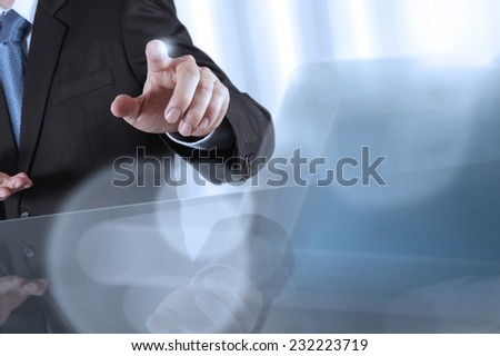 businessman hand pressing a touchscreen button on server background  - stock photo