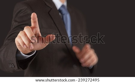 Businessman hand pressing an imaginary button on virtual screen