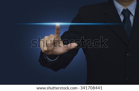 Businessman hand pressing power light over blue background, internet and networking concept - stock photo