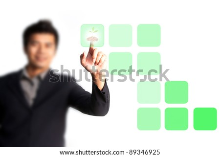 Businessman hand pressing tree button - stock photo