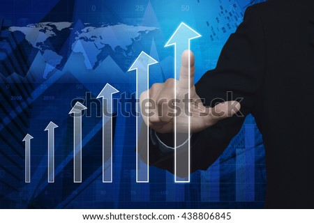 Businessman hand pushing arrow head graph over map and city tower, Success business concept