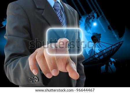 businessman hand pushing button and satellite dish antennas - stock photo
