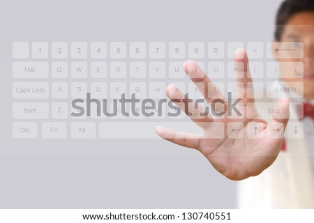 Businessman hand pushing button on a touch screen computer keyboard - stock photo
