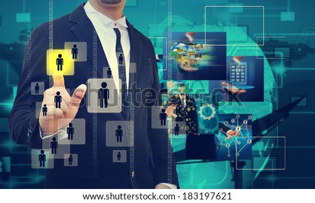 businessman hand pushing Choosing the right person - stock photo