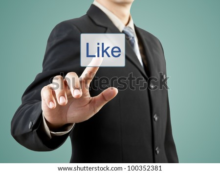 businessman hand pushing like button - stock photo