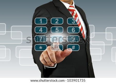 businessman hand pushing number pad screen