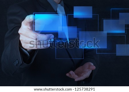 businessman hand pushing on a touch screen interface - stock photo