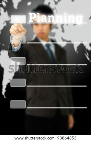 businessman hand pushing planning button on a touch screen interface