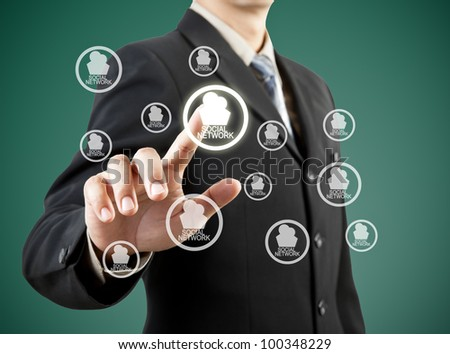 businessman hand pushing social network