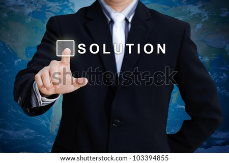 Businessman hand pushing solution button - stock photo