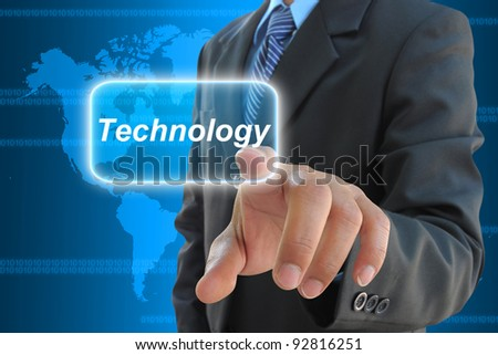 businessman hand pushing technology button on a touch screen interface - stock photo