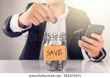 Businessman Hand Put Coins to glass for investment Of Coins - stock photo