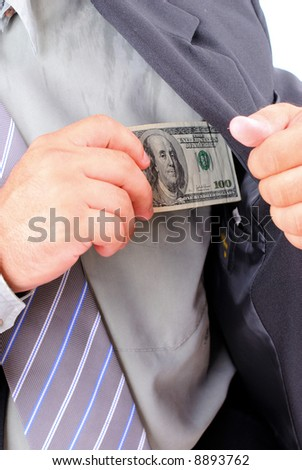 Businessman hand putting dollar in the pocket .