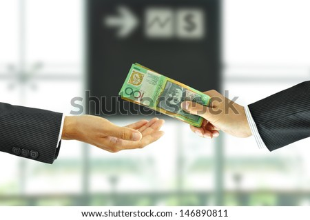 Businessman hand sending money - stock photo