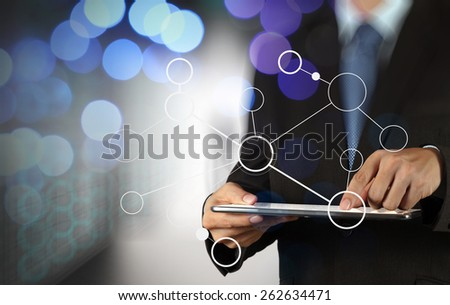businessman hand showing  blank flow chart on new modern computer as concept with bokeh exposure - stock photo