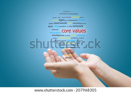 Businessman Hand Showing core values Word  - stock photo