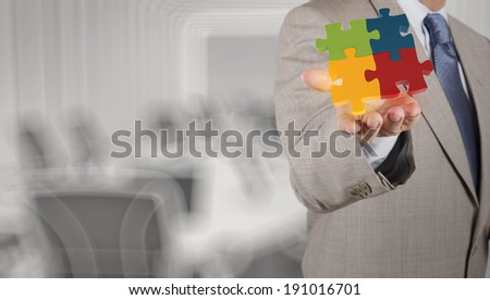 businessman Hand showing 3d puzzle as concept  - stock photo