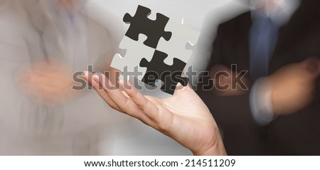 businessman hand showing 3d puzzle partnership sign as concept - stock photo