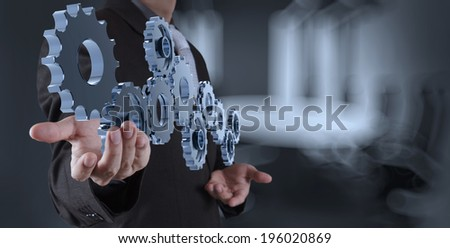 businessman hand showing gear to success concept as concept