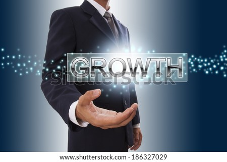 Businessman hand showing growth button on virtual screen.  - stock photo