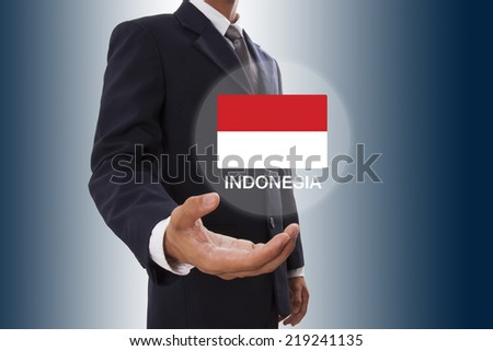 Businessman hand showing Indonesia Flag